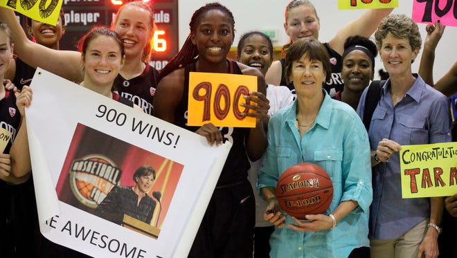 In this image provided by Plan BC3, Stanford coach Tara VanDerveer, third from right, poses with her players after their 83-59 win over Florida Gulf Coast in an NCAA college basketball game Wednesday, Nov. 27, 2013, in Puerto Vallarta, Mexico. VanDerveer became the fifth women's coach to reach 900 victories with Wednesday's win.