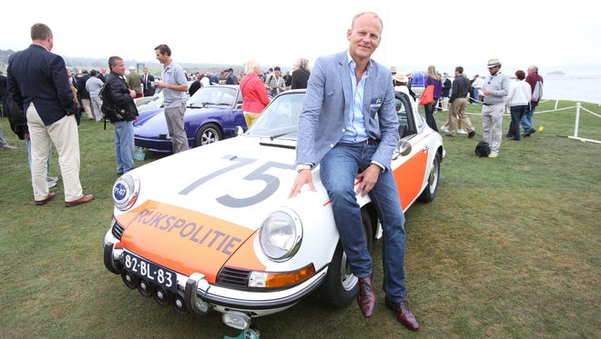 Guus Reinerink of Lichtenjoorde, the Netherlands, with his 1974 Porsche 911 Targa police car at the Pebble Beach Concours D'Elegance.