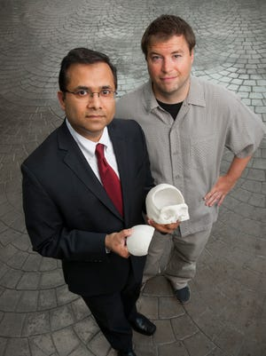 Dr. Gaurav Gupta successfully inserted a 3D printed skull bone into his patient, Christopher Cahill.