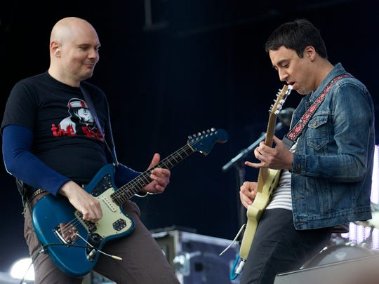 Billy Corgan (left) and Jeff Schroeder of The Smashing Pumpkins perform at the Glastonbury Festival of Contemporary Performing Arts in 2013.