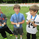 Anthony Widen, Ivo Unkefer, and Alex Sheppit show their medals which they won by doing the 5k at the Y last Tuesday. Gibraltar Schools, the Northern Door Y, and Door Ministry Health sponsored the event, which was organized by Mr. Annen, principal, and Vinni Chomeau. Students ran the length of Gibraltar Road down and back from the Y. Good job, students!