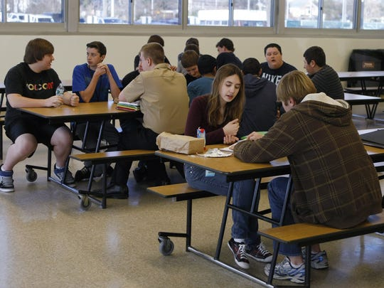 Wall High School students eat their lunch in the cafeteria.