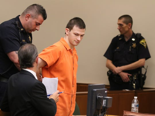 Colin Rideout is handcuffed to start serving his sentence.