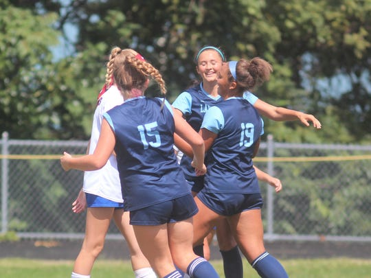 Teammates celebrate with Boone County senior Rielyn Hamilton, 19, after Hamilton scored her 103rd career goal in the opening minutes during Boone County's 5-1 win over Richmond Model in girls soccer Sept. 15, 2018 at Boone County HS, Florence KY. Rielyn Hamilton, an Akron commit, scored twice to set the new BCHS scoring record at 104 goals. during Boone County's 5-1 win over Richmond Model in girls soccer Sept. 15, 2018 at Boone County HS, Florence KY. Rielyn Hamilton, an Akron commit, scored twice to set the new BCHS scoring record at 104 goals. during Boone County's 5-1 win over Richmond Model in girls soccer Sept. 15, 2018 at Boone County HS, Florence KY. Rielyn Hamilton, an Akron commit, scored twice to set the new BCHS scoring record at 104 goals.