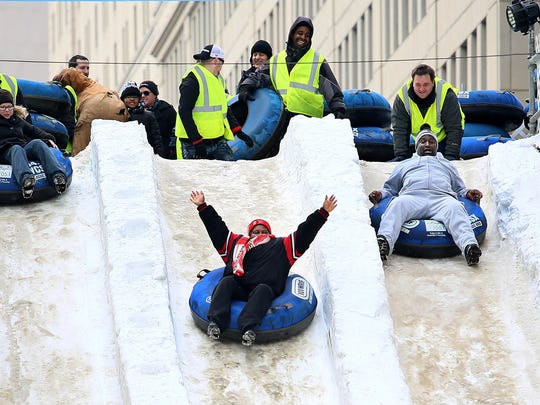 People brave the snow slide during the 2015 Meridian Winter Blast in Campus Martius park in downtown Detroit on Saturday, Feb. 7, 2015.