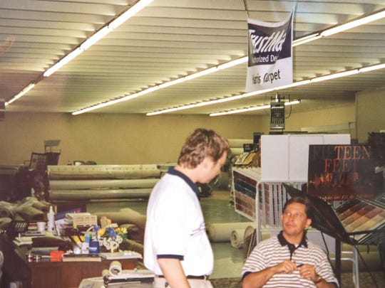 Scott Junkin, left, seen working in Harris Carpet store in 1999. The store was on River Street, after being in the Bailes Building, and before moving to the current location  in 2008.