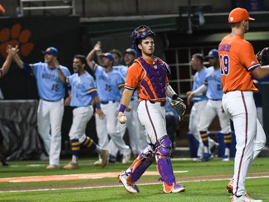 Clemson sophomore catcher Kyle Wilkie (10) looks at