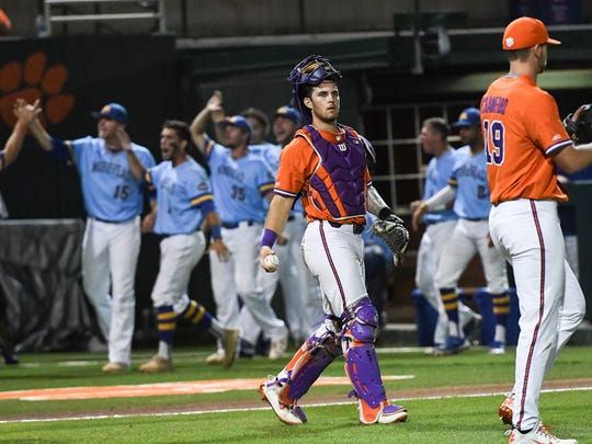 Clemson sophomore catcher Kyle Wilkie (10) looks at Clemson junior pitcher Brooks Crawford (19) after Morehead State senior Eli Boggess (11) scored during the top of the second inning of the NCAA Clemson Regional at Doug Kingsmore Stadium in Clemson on Friday, June 1, 2018.