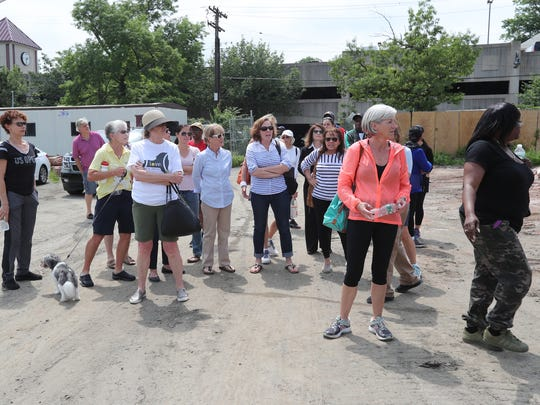 A group of people in support of the tennis center arrive for a press conference by Mount Vernon Mayor Richard Thomas about the demolition of the tennis center at Memorial Field on Friday, June 1, 2018.