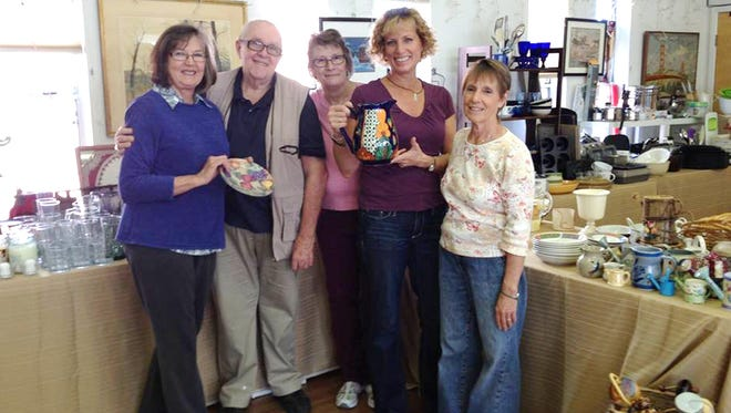 Preparing for the 111th annual bazaar at the Church of the Good Shepherd on Tuesday were, from left, Mary Ihlefeld, Larry McLellan, Nyla Howard, Jill Olson and Linda Shay.