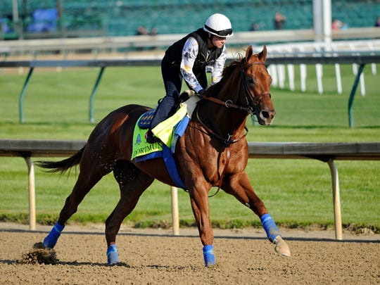 Exercise rider Dana Barnes works out Kentucky Derby hopeful Dortmund.