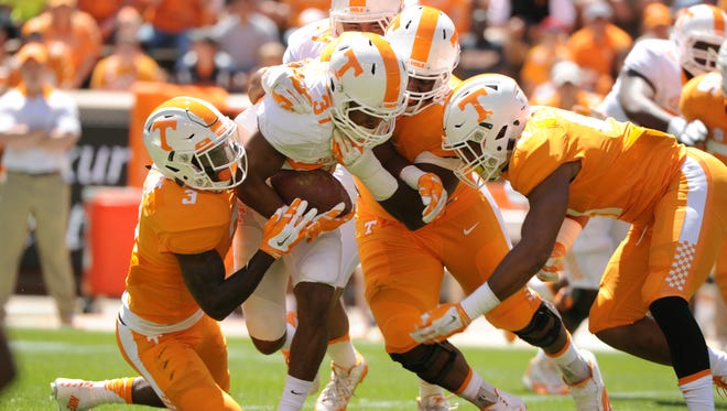 Jayson Sparks is tackled by several defensive players during action at the UT Orange and White Spring Game Saturday, April 16, 2016.