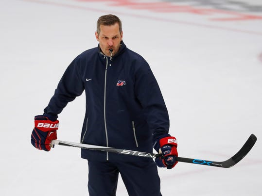 FILE - In this March 30, 2017, file photo, United States coach Robb Stauber skates during practice in preparation for the IIHF Women's World Championship hockey tournament, in Plymouth, Mich. Stauber can't miss seeing the Olympic rings painted at center ice, even on the practice rink. The former goalie is doing his best to ignore all the reminders that he is making his head coaching debut on the world's biggest stage for women's hockey at the 2018 Winter Olympics. (AP Photo/Paul Sancya, File)