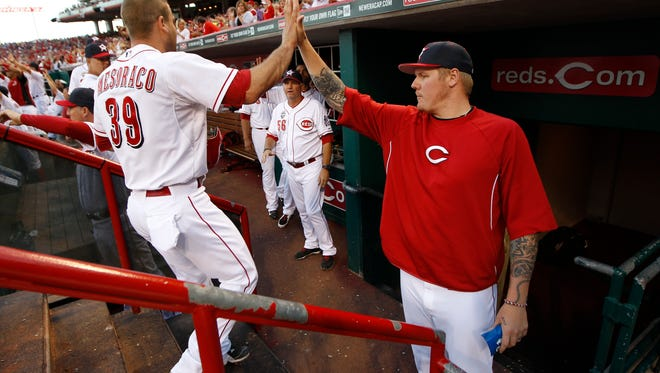 Reds catcher Devin Mesoraco is congratulated by pitcher Mat Latos after scoring on July 4.