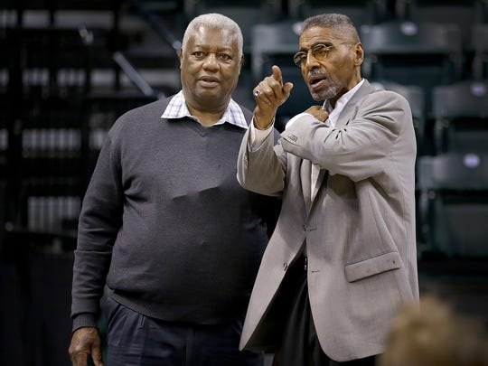 Crispus Attucks legend Oscar Robertson talks with usher Cleveland Harp before the start of IHSAA 3A Boys Basketball State Finals game Saturday, March 25, 2017, evening at Bankers Life Fieldhouse.
