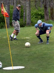 Chris Goodman, right, watches his shot miss to the amusement of Dennis Roque during a round of Footgolf at Meadow Park Golf Course, in Tocoma, Wash. The course is similar to opening at Valley Oaks Golf Course in Visalia. In addition to the 21-inch-wide holes, there are a few other changes to the golf game. The holes are shorter and one can play 18 holes in about 90 minutes.