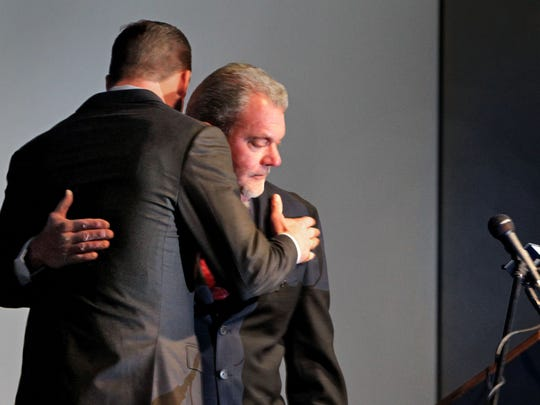 Jim Irsay, right, and Peyton Manning, left, embrace during the team's announcement of Manning's release, March 7, 2012.