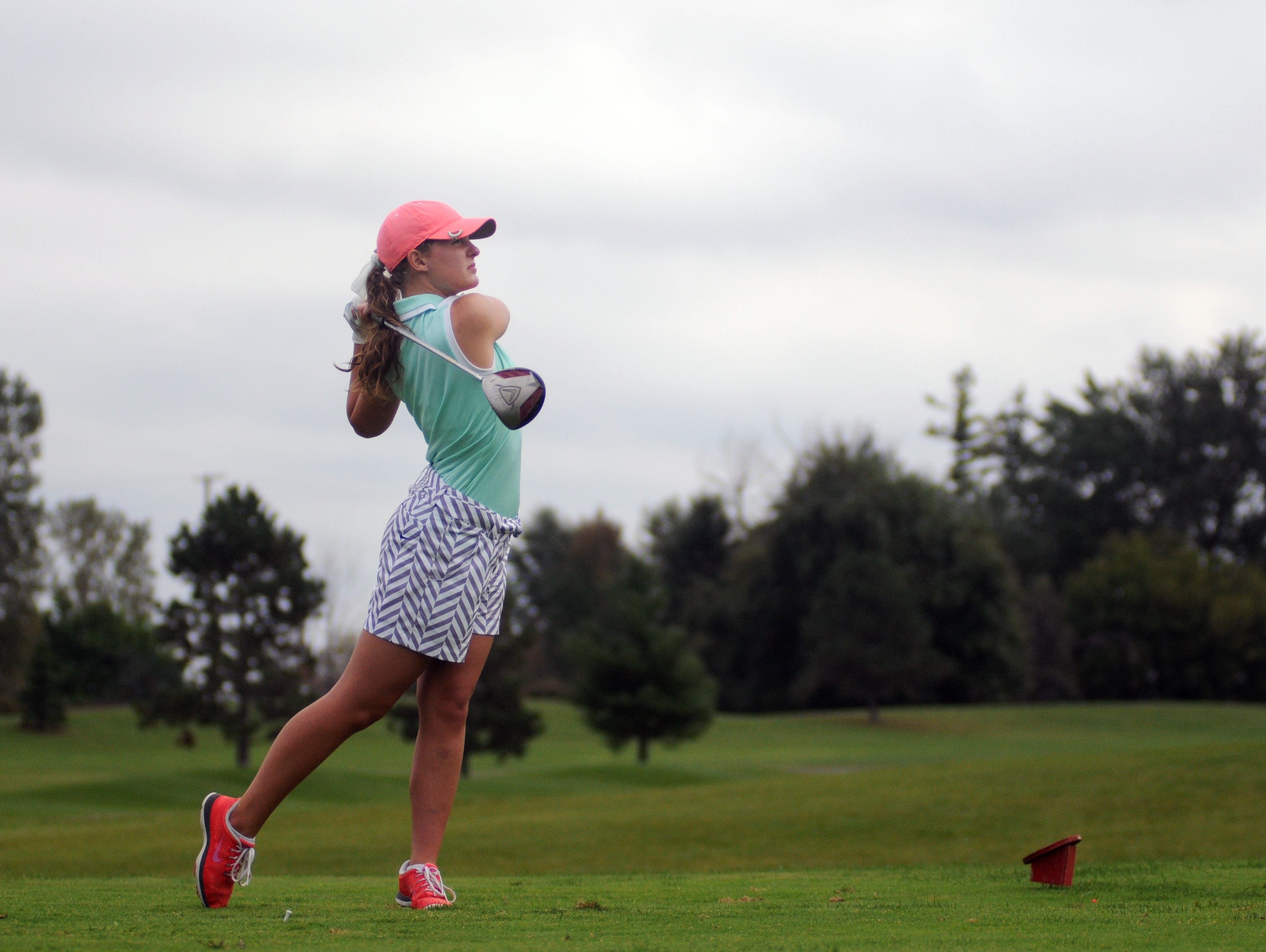 Capac golfer Emma Kerr tees off Monday, Oct. 5, during the St. Clair County Golf Tournament at Holly Meadows Golf Course in Capac.