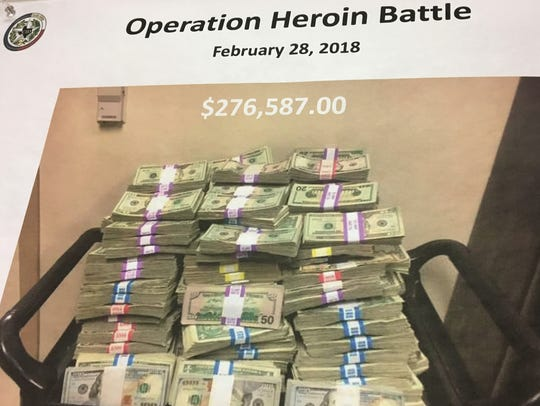 A photo shows cash seized by the Texas Department of