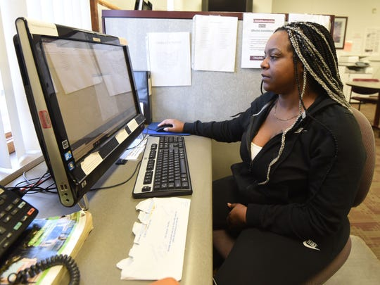 Aubreyana Johnson of Mansfield uses the facilities at the Richland County Department of Job and Family Services on Tuesday afternoon.