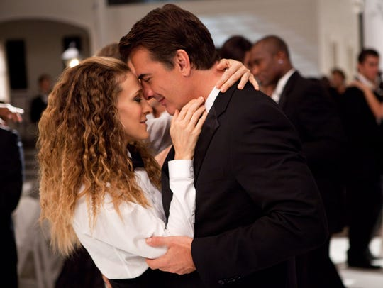 Sarah Jessica Parker as Carrie Bradshaw and Chris Noth