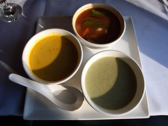 The soup sampler with Creamy Edamame, Shrimp Tom Yum and Pumpkin Bisque at Mr. Chung's Contemporary Asian Cuisine.