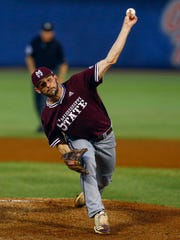 Mississippi State's Ethan Small throws a pitch during the first inning of the team's Southeastern Conference tournament NCAA college baseball game against Vanderbilt, Thursday, May 23, 2019, in Hoover, Ala. (AP Photo/Butch Dill)