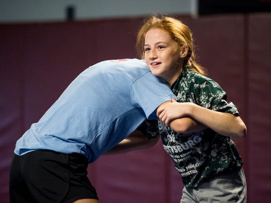 Maddi Wellen, left, wrestles with Montana DeLawder at the Gladiator Wrestling Club in Orrtanna.