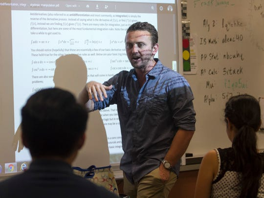 Dunbar High School math teacher Frank Savage works with his students after school on Wednesday, October 28, 2015, in Fort Myers.