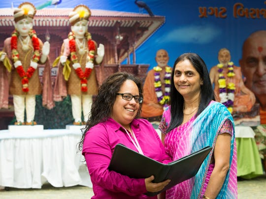 Christiana Care Cancer Outreach Navigator Joceline Valentin talks with Chhaya Patel during a visit to the Hindu temple.