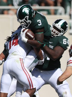 Michigan State Spartans RB LJ Scott runs the ball as Brandon Clemons blocks against the Wisconsin Badgers in the first half Saturday, Sept. 24, 2016 at Spartan Stadium in East Lansing.