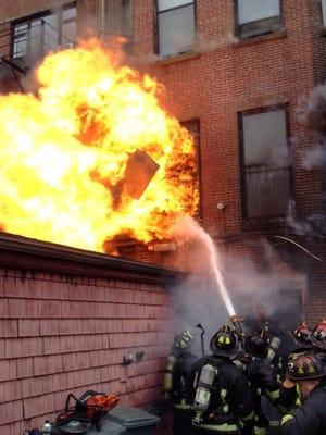 Boston firefighters battle a nine-alarm blaze in the Back Bay neighborhood.