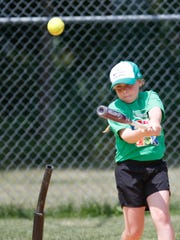 Jessica Tudor, 8, from Garrison practices her hitting