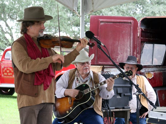 A musical group plays for visitors to the King Ranch during the annual Ranch Hand Breakfast.