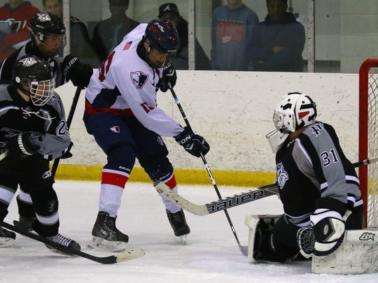 Closing in on Plymouth goalie Trevor McManus is Livonia