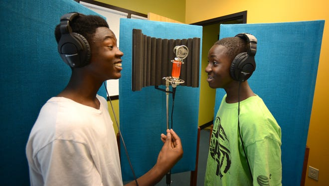 Takelyn Kelly, left, and Darius Buchanan rehearse a song in the new recording studio at the Boys and Girls Club of Green Bay's west-side location.