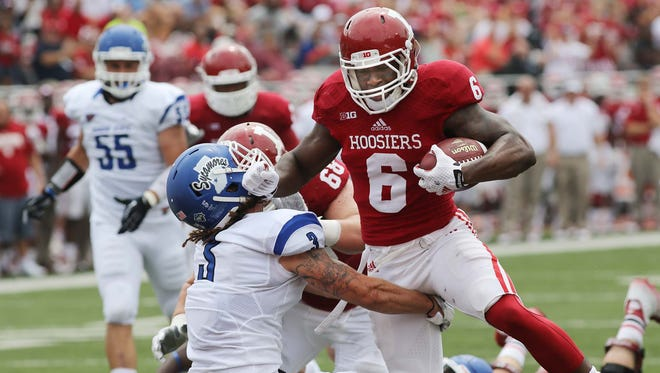 Tevin Coleman of IU breaks a tackle attempt by by ISU's Donovan Layne to score IU first TD of the game. Indiana University defeated Indiana State University 28-10 in a football game at Memorial Stadium in Bloomington Saturday August 30, 2014.