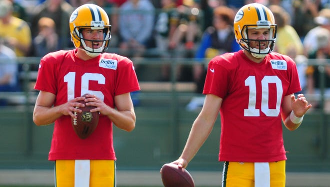 The Green Bay Packers kept Scott Tolzien, left, and Matt Flynn on cut-down day Saturday, keeping three quarterbacks for the first time since 2008.