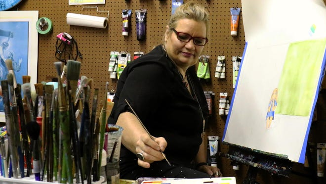 Gallery owner and artist Melody Smith works on a watercolor piece, Thursday, August 27, for an upcoming show at the recently opened The Gallery on Garrison, 914 Garrison Avenue, in downtown Fort Smith. The Gallery features area artist with works ranging from visual arts to jewelry and sculptures and will host an open reception September 4, 6 - 8:30 p.m. for artist Victus and Austin Anderson.