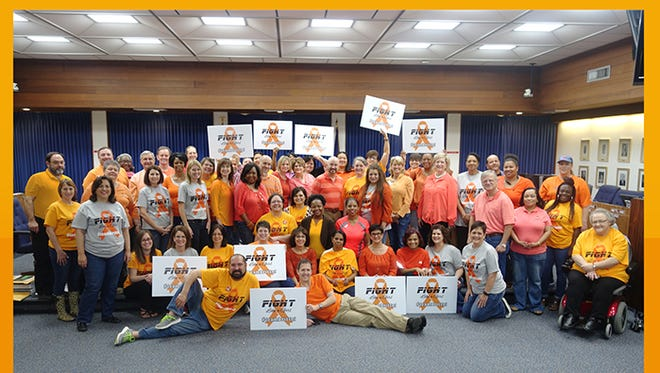 Lafayette Parish School System central office staff dressed in orange and held a fundraiser Friday for Brittni Clements.