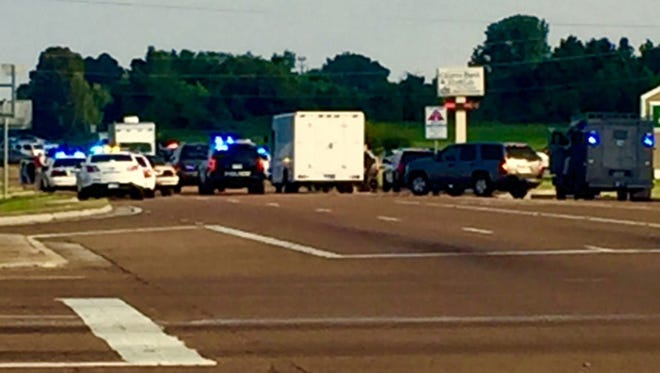 A man died in a standoff with police at Goodman Road and Hwy. 301 in DeSoto County.
