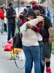 Jennifer Reedom, left, and Porcha Reedom embrace Tuesday, March 13, 2018 before a candlelight vigil among family and friends of Jontell Reedom. An altercation between Jontell Reedom and Tulare Police ended there on Monday. Reedom, a standout athlete at Tulare Union High School in 2008, died from gunshots he received during the struggle.