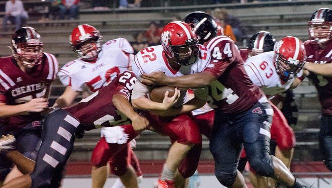 Mikey Chennault tries to break free Friday night. Chennault finished with 206 yards and two touchdowns in Jo Byrns loss to Cheatham County.