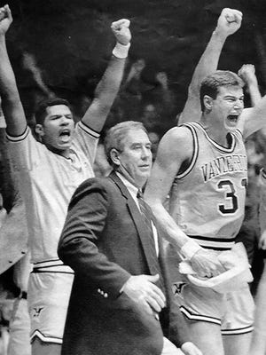 Vanderbilt coach C.M. Newton celebrates a win over Kentucky in 1988.