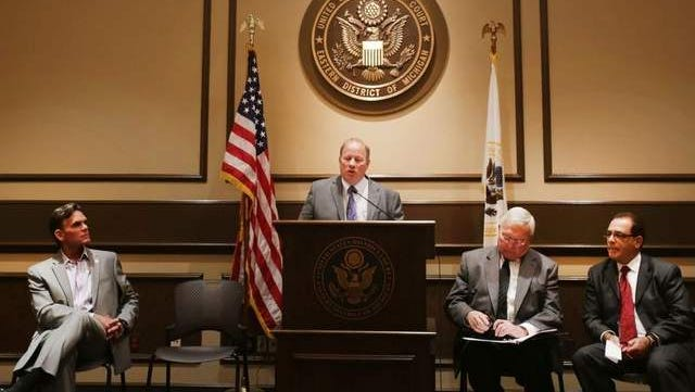Detroit Mayor Mike Duggan, at the podium, announces a 40-year deal that has been struck with Macomb, Oakland and Wayne Counties to form a regional water authority that will provide $50 million annually to help finance city system upgrades.