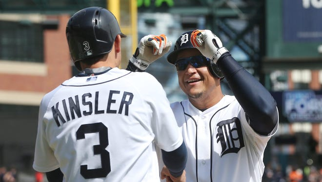 Detroit Tigers' Miguel Cabrera, right, is congratulated by teammate Ian Kinsler after they both scored on Cabrera's two-run home run during the seventh inning of a baseball game against the Minnesota Twins, Thursday, May 14, 2015, in Detroit.