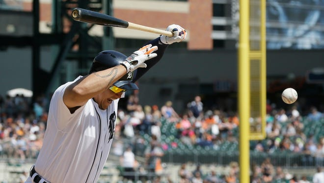 The ball bounces off Miguel Cabrera's left knee as he is hit by a pitch on Sunday.