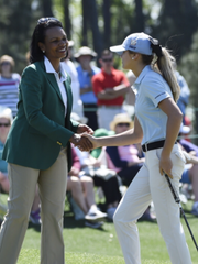 Adamsville golfer Karson Adkins shakes hands with former Secretary of State Condoleeza Rice after competing in the Drive, Chip, Punt championship at Augusta National on Sunday.