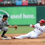 ARLINGTON, TX - SEPTEMBER 7: Chris Taylor #1 of the Seattle Mariners misses the tag on Leonys Martin #2 of the Texas Rangers steal ing second base in the sixth inning at Globe Life Park in Arlington on September 7, 2014 in Arlington, Texas. (Photo by Rick Yeatts/Getty Images)