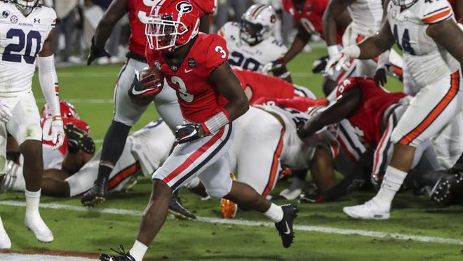 Georgia running back Zamir White (3) scores against Auburn during the first half of an NCAA college football game Saturday, Oct. 3, 2020, in Athens, Ga.